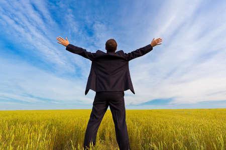 businessman standing on field photo