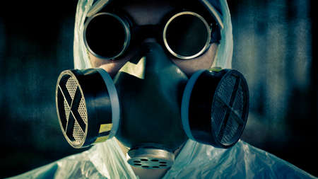 closeup man face in respirator and glasses photo