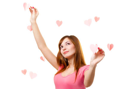 brown-haired beautiful woman touching heart shape over white Stock Photo - 8671549