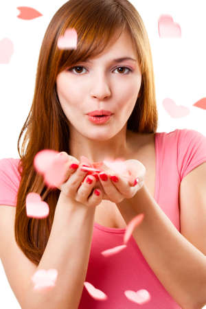beautiful woman blowing up kiss with hearts photo