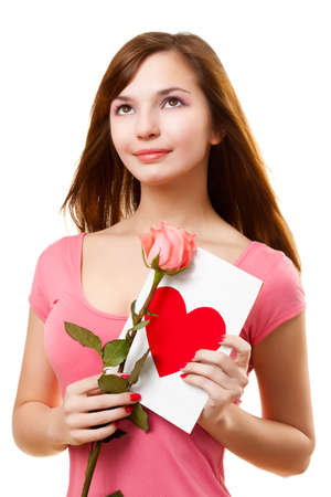 beautiful woman dreaming with card and rose flower over white photo