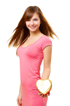 flying hair: woman with flying hair hold heart shaped gold box