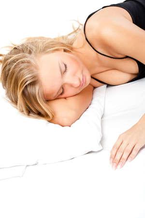 beautiful blonde woman sleeping on white bed photo
