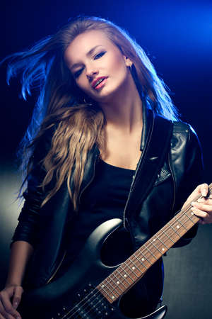 blonde woman rock star portrait with guitar photo
