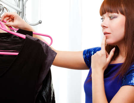 personal shopper: ginger woman finding clothes at store Stock Photo