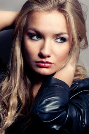closeup beautiful blonde woman portrait, rock style photo
