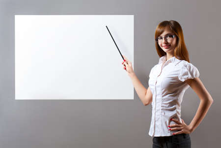 smiling woman showing with pointer to blank placard photo