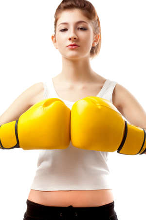 young woman wearing yellow boxer gloves Stock Photo - 8987091