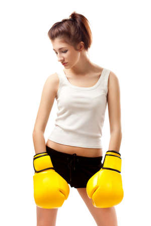 young woman wearing yellow boxer gloves photo