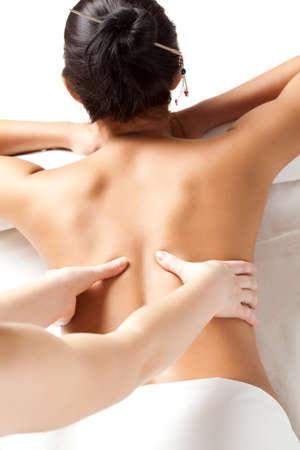 massage hands: woman receiving back massage over white
