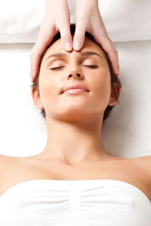 hands massage: pretty woman receiving face massage, closeup photo