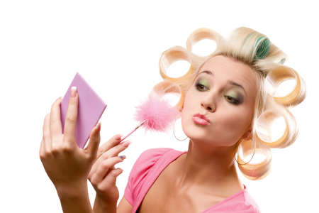 rollers: blonde woman with rollers on head over white Stock Photo