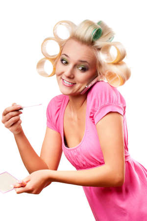 curlers: funny blonde woman with rollers on head over white