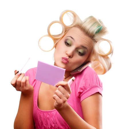 funny blonde woman with rollers on head over white photo