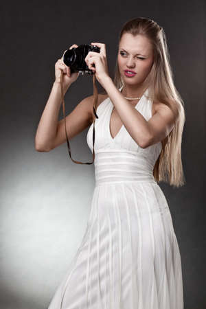 blonde woman with vintage camera over dark background Stock Photo - 9168804