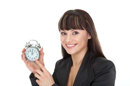 woman holding metallic alarm  clock over white photo