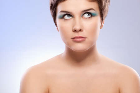 brunette woman portrait with blue makeup over white Stock Photo - 9361607