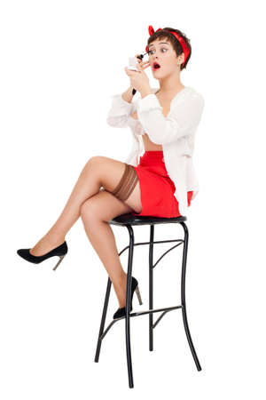 pinup style attractive woman portrait over white Stock Photo