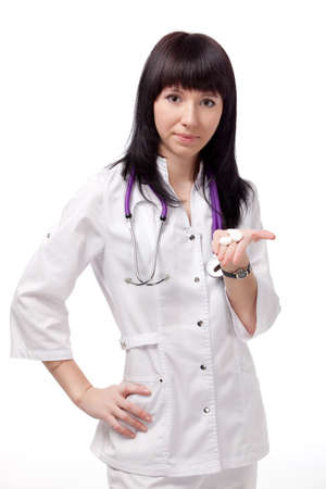 beautiful woman doctor with phonendoscope over white photo