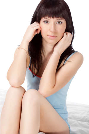 attractive woman sitting on bed over white Stock Photo - 9592290