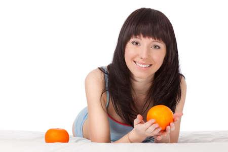 woman on bed beautiful holding orange Stock Photo - 9680961