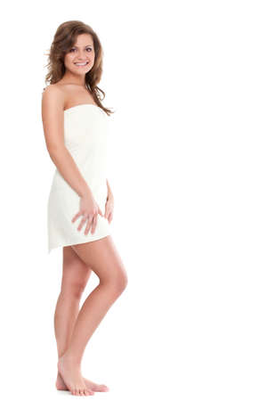isolated standing woman wearing bath  towel over white photo