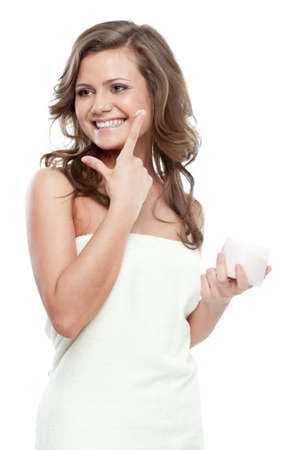 beautiful woman after bath holding jar with cream photo