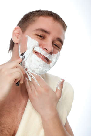 attractive man shaving his face over white photo