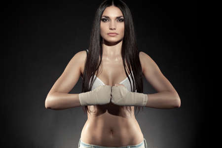 boxer: beautiful woman boxer portrait wearing bandage on hands