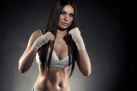 female boxer: beautiful woman boxer portrait wearing bandage on hands
