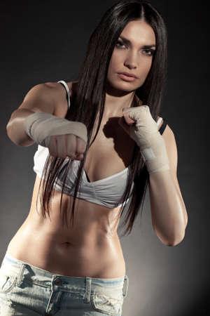 female boxer: beautiful woman boxer portrait wearing bandage on hands