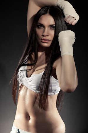 beautiful woman boxer portrait wearing bandage on hands  photo