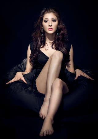 vogue: woman fashion model posing over dark black