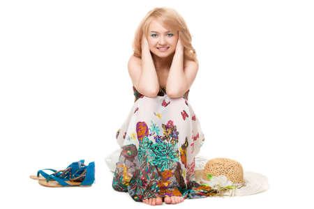 sundress: blond pretty woman posing wearing summer dress over white studio portrait