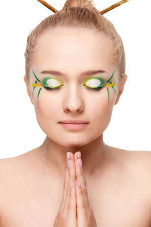 woman face with bamboo leaves style makeup over white Stock Photo - 10229625