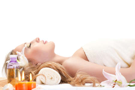 facial spa: woman taking over spa treatment over white