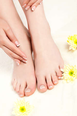 woman feet standing on towel, spa style photo