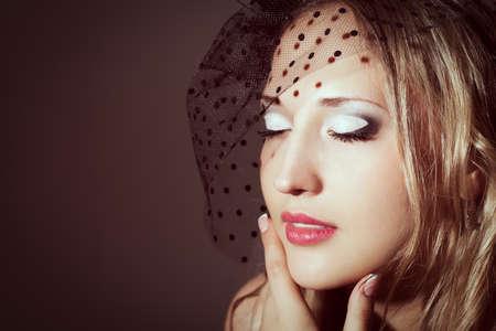 closeup woman face retro styled studio portrait photo
