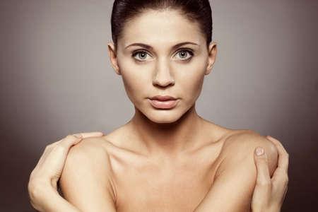 beautiful woman closeup studio portrait, brorwn tint Stock Photo - 10333625