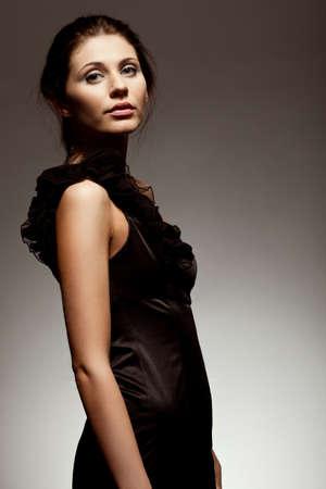 woman wearing black dress, studio portrait over gradient background Stock Photo - 10333616