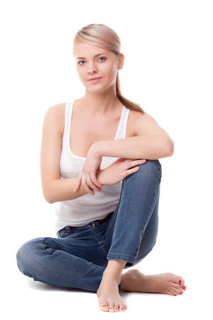 woman sitting floor: beautiful woman sitting on the floor over white Stock Photo