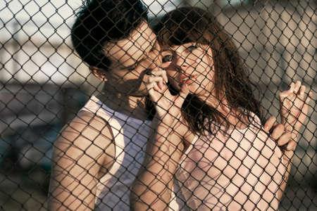 embaring couple standing near lattice photo