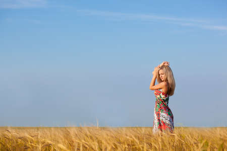 beautiful woman walking on wheat field Stock Photo - 10601105
