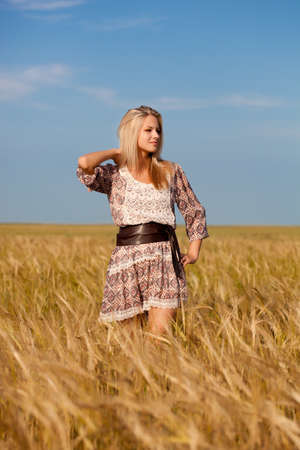 beautiful woman walking on wheat field Stock Photo - 10601097