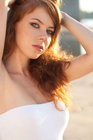 red haired girl: closeup red-haired woman portrait outdoors
