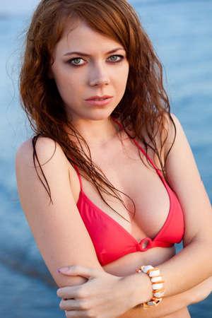 redhaired: beautiful red-haired  woman wearing bikini on beach