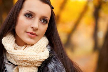 autmn: closeup brunette woman portrait in autmn park Stock Photo