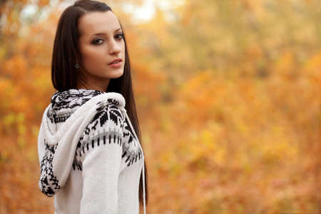 autmn: closeup beautiful woman looking around in autmn park