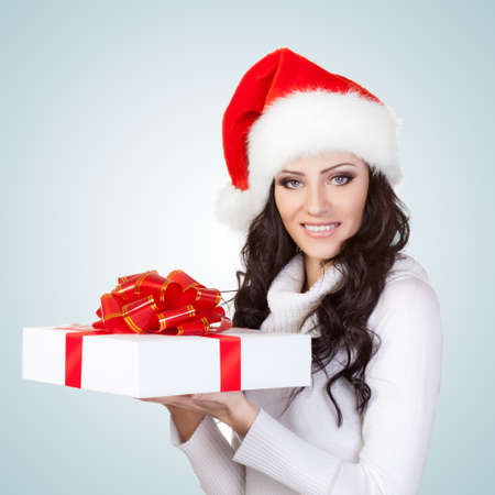 woman wearing christmas hat and holding gift box photo