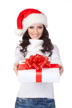 woman wearing christmas hat and holding gift box, isolated photo